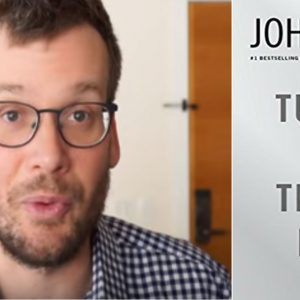 John Green next to cover of Turtles All the Way Down
