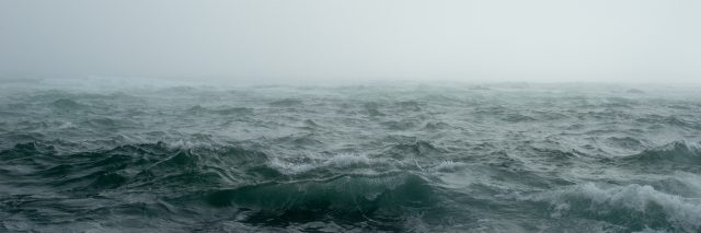 misty ocean scene during storm with rough waves