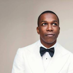 Leslie Odom, Jr. wearing white tuxedo and black bowtie