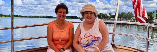 two women sitting in a boat