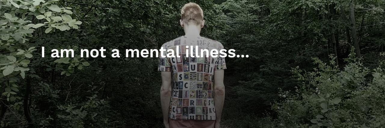 A man walking down a path. Text reads: I am not a mental illness
