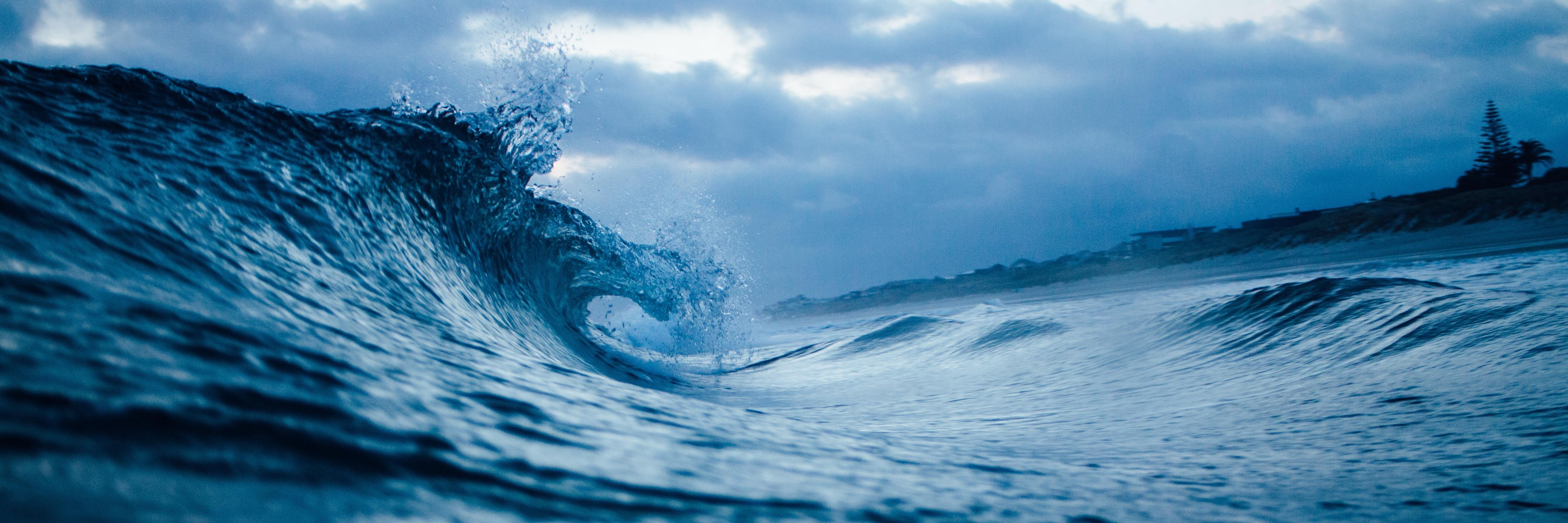 ocean wave on dark day heading towards shore