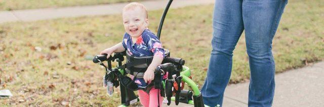 Little girl in her walker