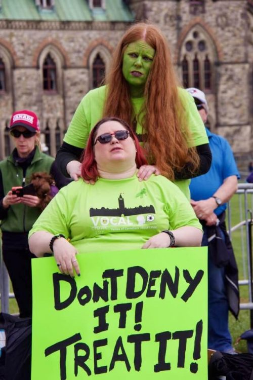woman in a wheelchair at a lyme disease rally with her wife