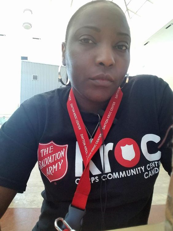 woman at work wearing a salvation army shirt