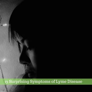 3 Surprising Symptoms of Lyme Disease text on black and white side profile of woman's face