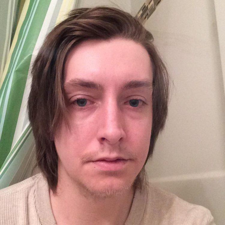 selfie of a man looking tired