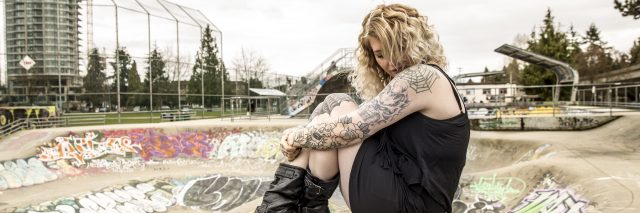The writer, sitting at a skater's park.