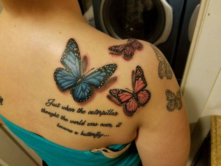 woman with butterfly tattoos on her shoulder