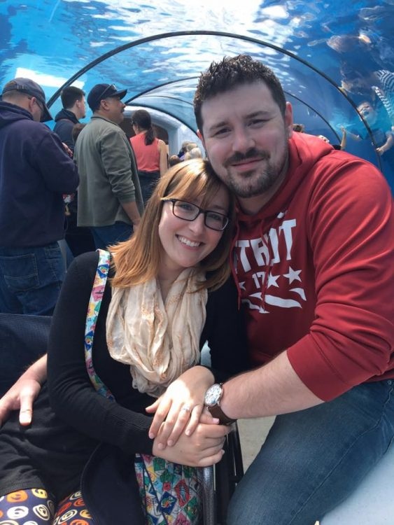 woman and her boyfriend smiling at an aquarium