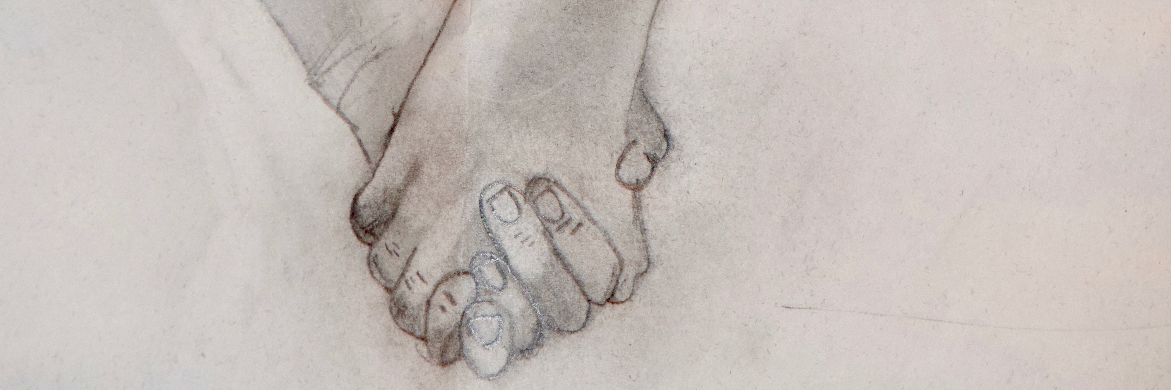 pencil drawing of two people holding hands