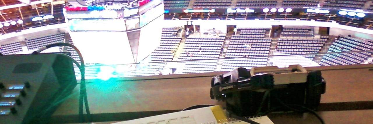 paperwork on desk overlooking NHL stadium
