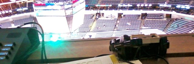 paperwork on desk overlooking NHL stadium