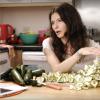A woman peeling Zucchini