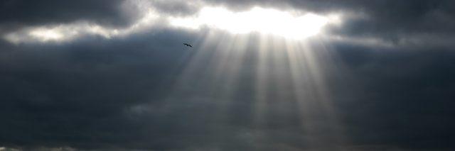 Light breaking through the dark clouds.