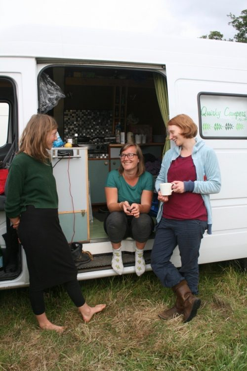 friends hanging out and talking around the quirky campers van