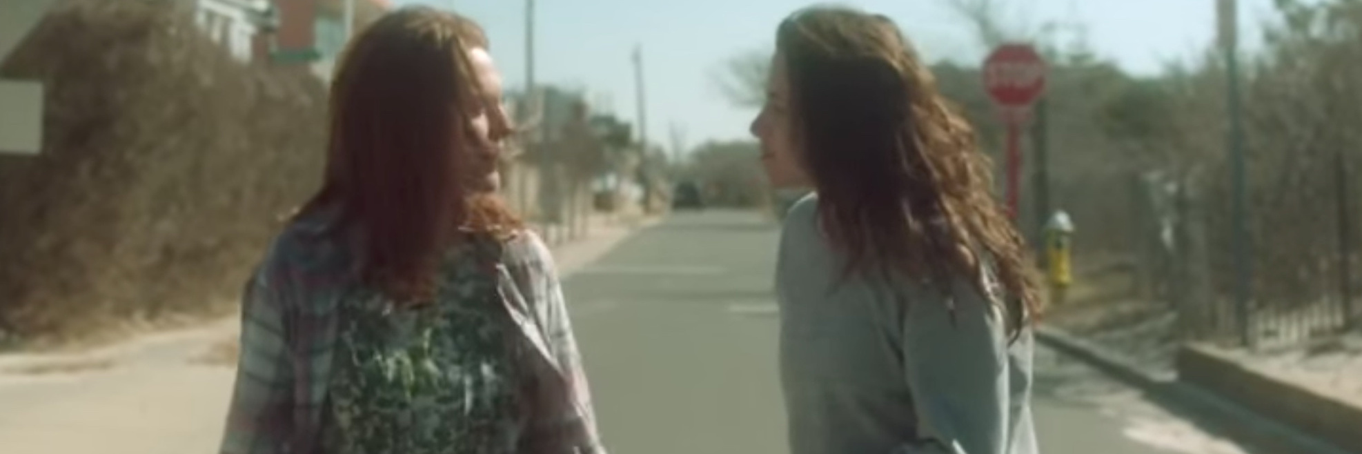 A scene from the movie Still Alice: Kristen Stewart and Julianne Moore walking down a street, having a conversation