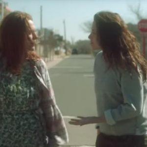 A scene from the movie Still Alice: Kristen Stewart and Julianne Moore walking down a street, having a conversation