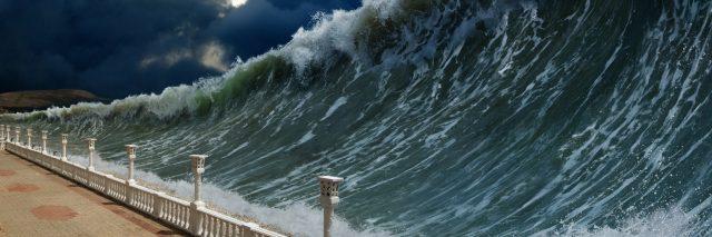 tsunami crashing over land