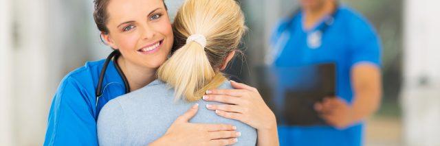 nurse hugging her patient