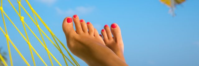 woman's feet in a hammock on the beach