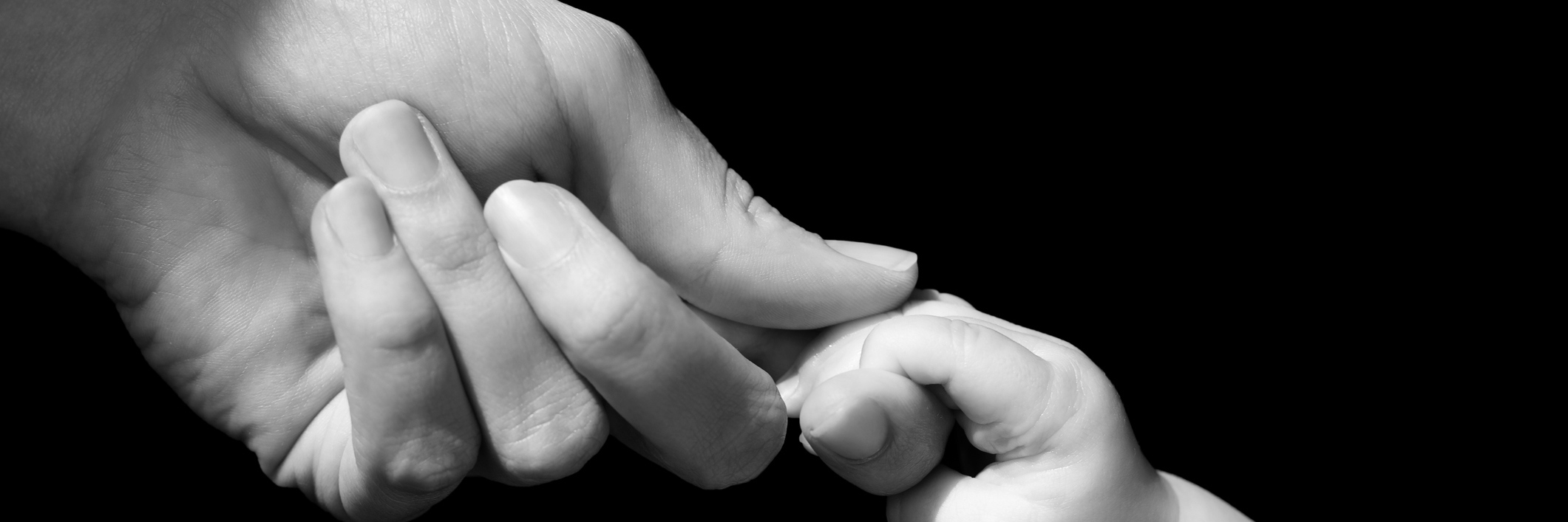 Hands of mother and baby closeup