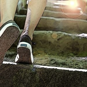 Young woman climbing stairs.