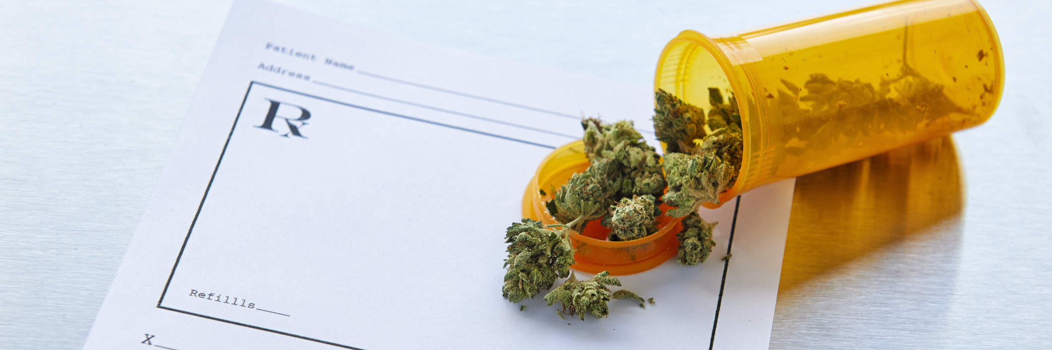 photo of marijuana spilled over a prescription
