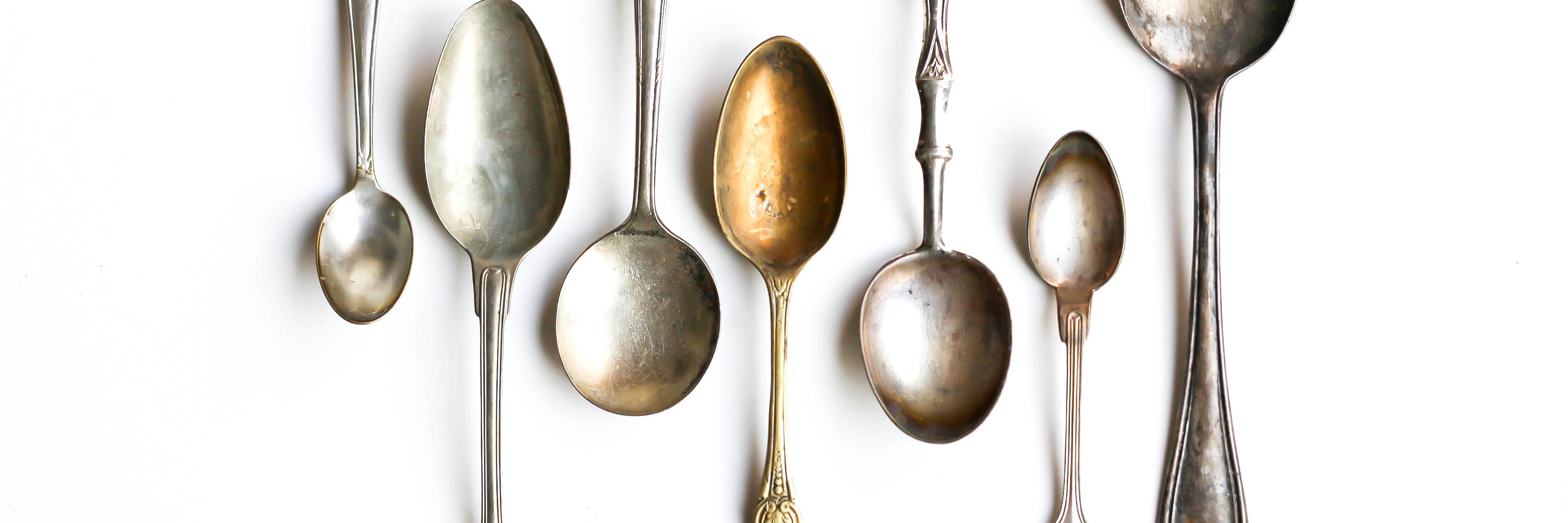 various antique silver spoons