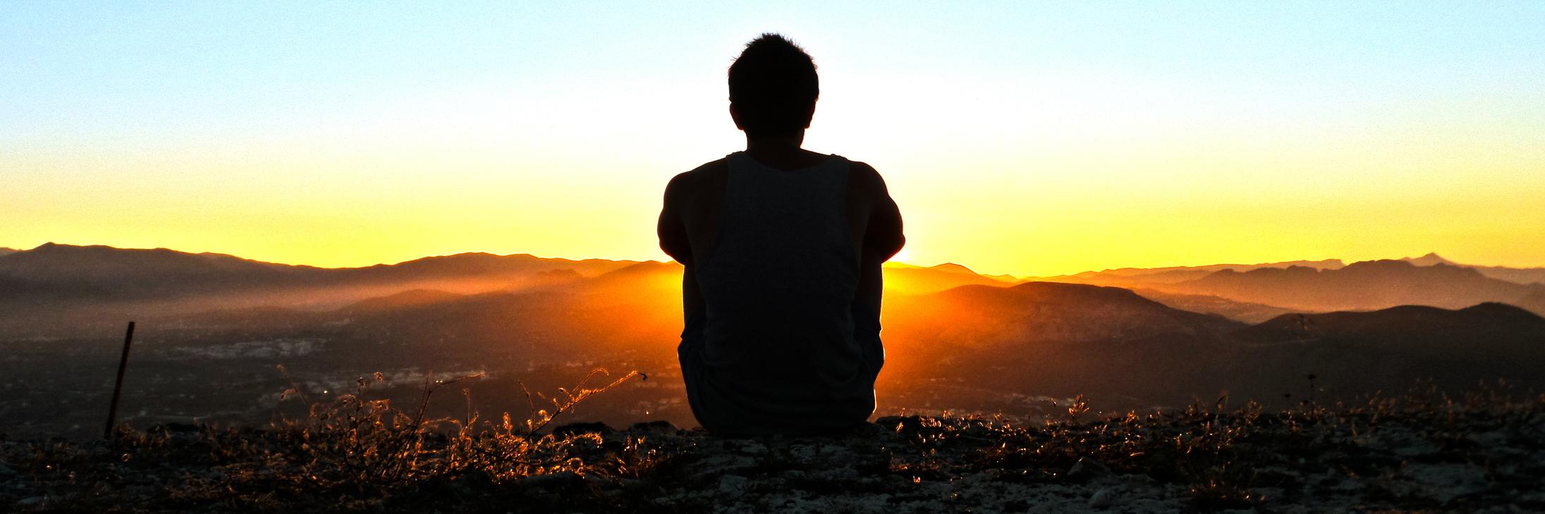 man reflecting at perfect sunset