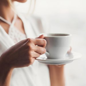 woman drinking coffee in soft light