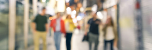 Blurred defocused abstract background of people walking on the street by night with - Nightlife concept with young friends hanging out together in city center - Cold neutral filtered look