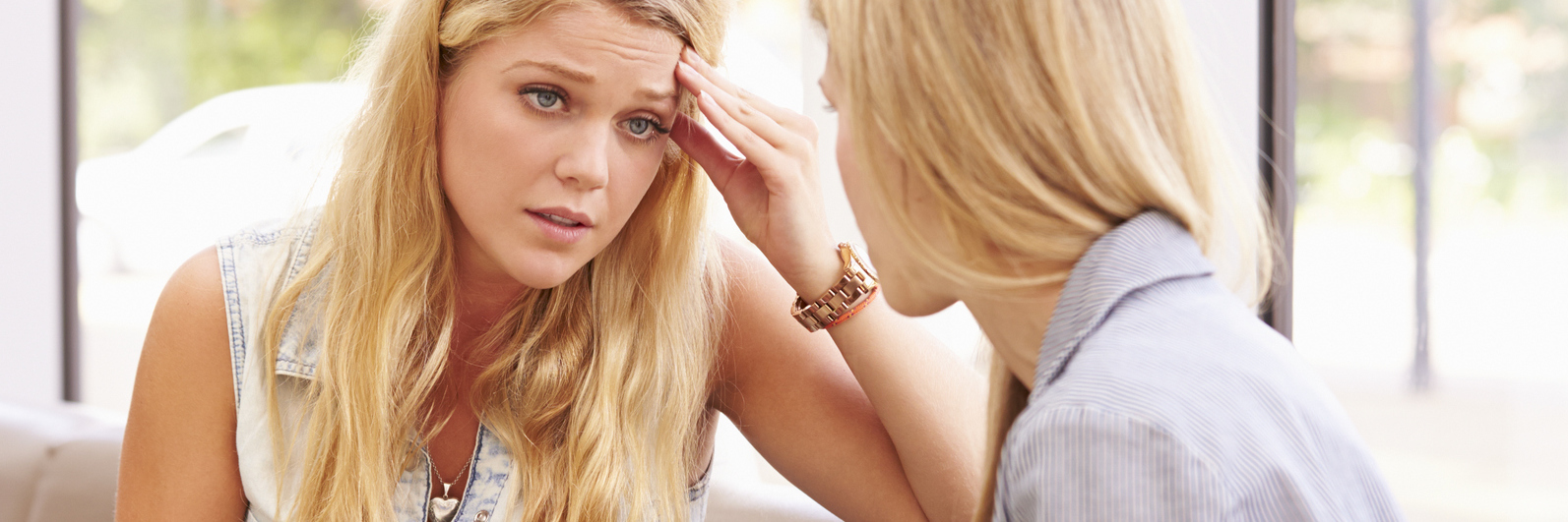 depressed college student talking to counselor of similar age