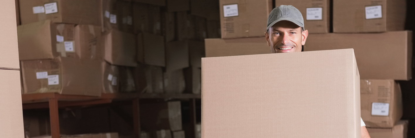 Worker carrying boxes in the warehouse.