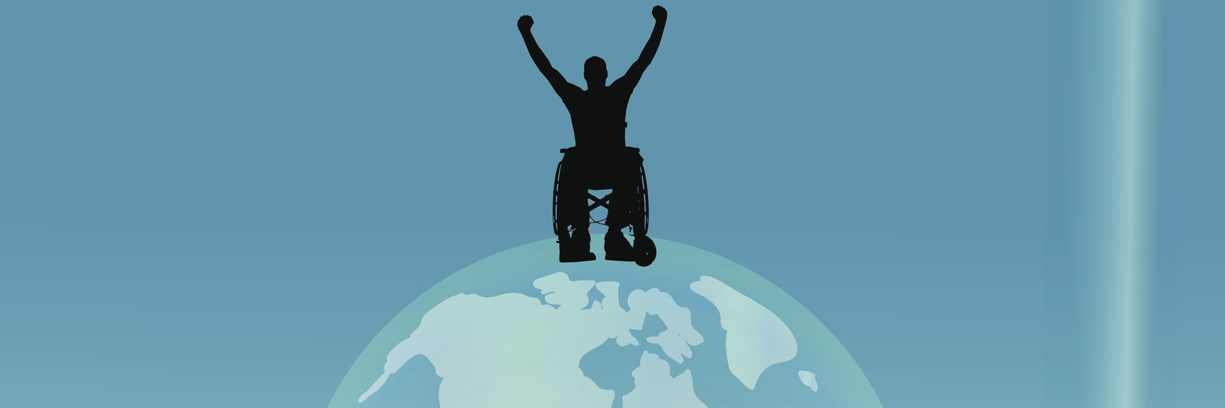 Silhouette of man in wheelchair sitting on top of the world.
