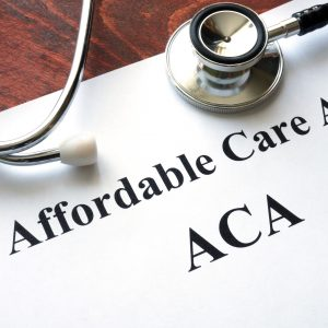 Affordable Care Act ACA written on a paper.
