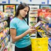 woman checking food labels at the grocery store