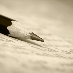 Pencil on a letter in sepia tone.