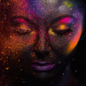 Galaxy-themed colorful art of a woman.