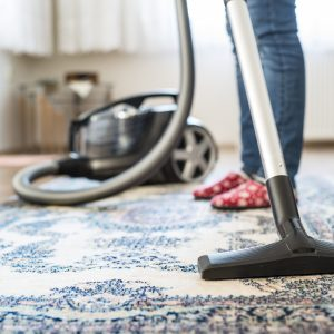 woman vacuuming her apartment