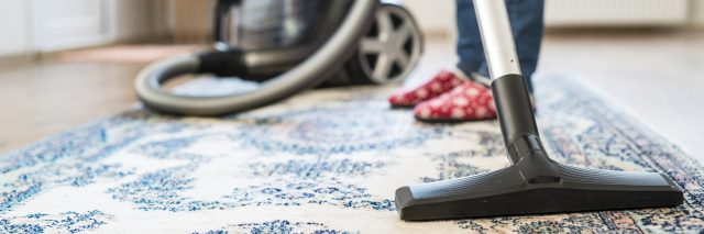 woman vacuuming her apartment