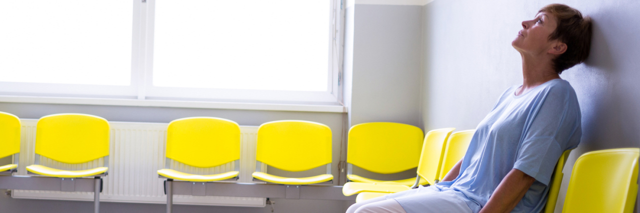 woman sitting in a waiting room at a doctor's office