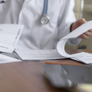 doctor looking at patient's medical records