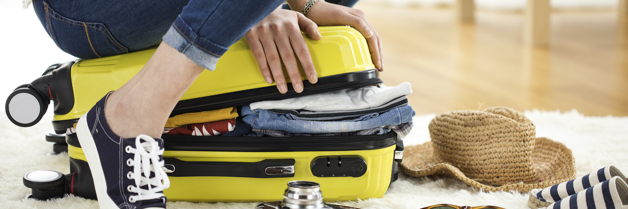 Packing travel suitcase.