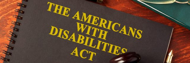 Americans With Disabilities Act (ADA) notebook and gavel.