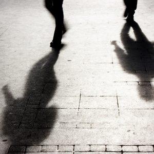 shadows of people walking