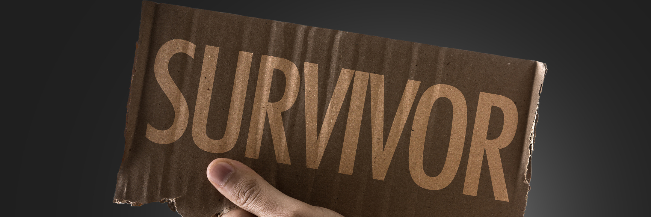 hand holding survivor sign