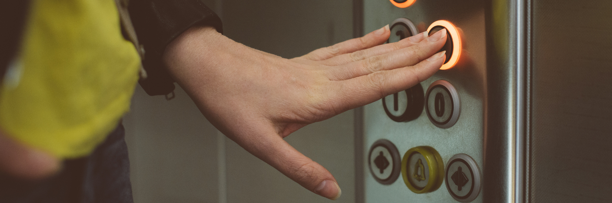 woman pressing buttons in an elevator
