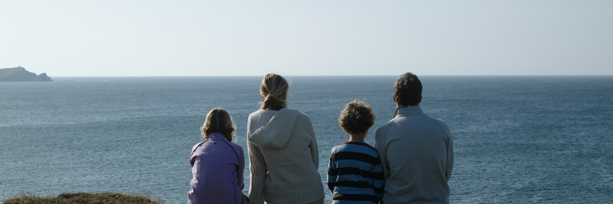 Family looking at the ocean.
