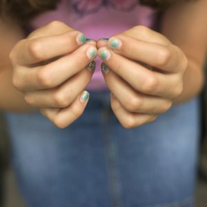 A girl with painted nails